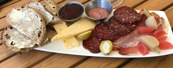house-made charcuterie and cheeses and pickled veggies