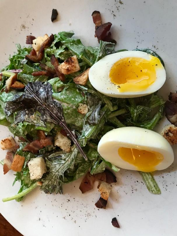 Farmhouse Salad was made with greens from the local Hay Shaker Farm, lardons, a soft-boiled egg, and dressed with a mustard vinaigrette