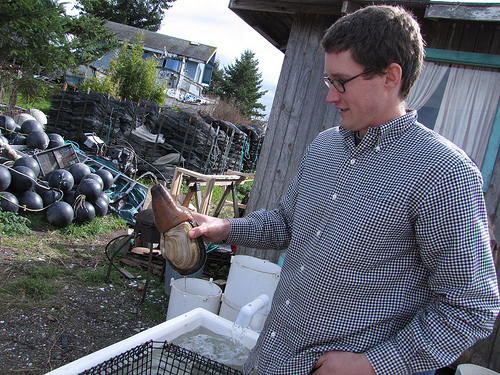Nick Jones holding a Geoduck