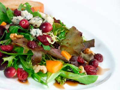 Green Salad with Pomegranate Vinaigrette and Goat Cheese