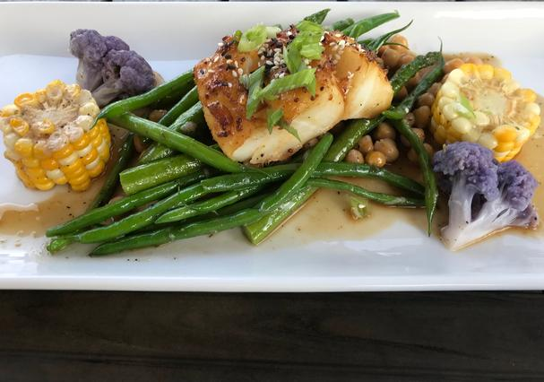 Sable fish with corn, beans, and cauliflower