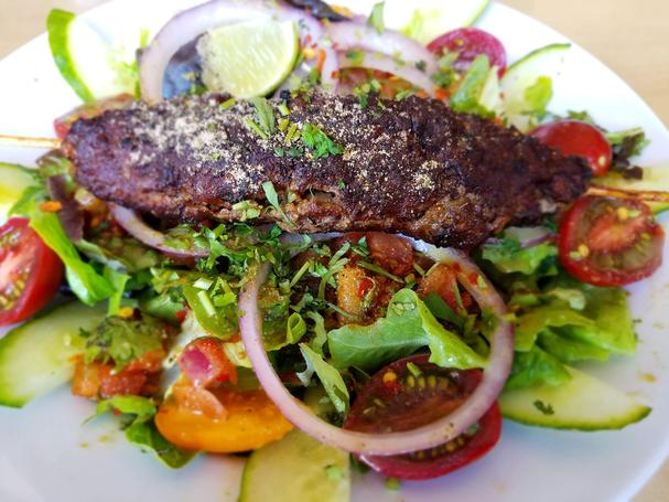 Kachumber Salad: Lime marinated tomato salad with cucumbers and onion