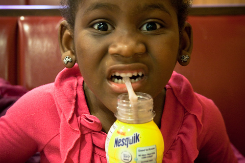 Little girl drinking chocolate milk
