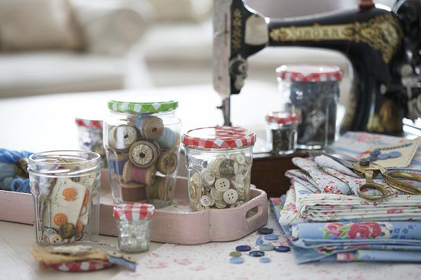 Recycled jam jars for holding sewing supplies