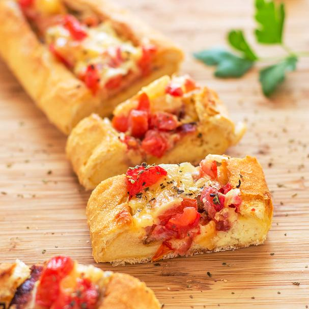 Breakfast Boat with tomatoes, bacon, and cheese