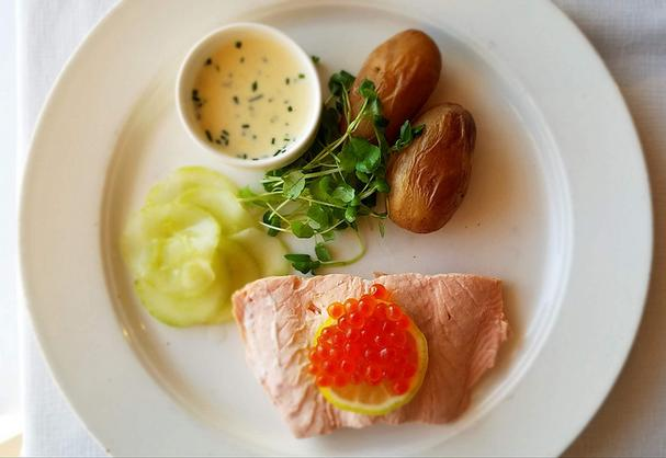 Poached Salmon with creamy chive sauce and pickled cucumbers